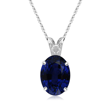 0.70 Cts of 6x4 mm Oval AA Blue Sapphire Scroll Pendant in Platinum