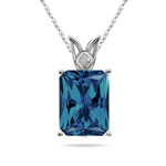 1.86 Cts of 8x6 mm AAA Emerald Radiant London Blue Topaz Scroll Solitaire Pendant in Platinum