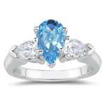 0.20 Cts Diamond & 4.55 Cts Swiss Blue Topaz Three Stone Ring in 18K White Gold