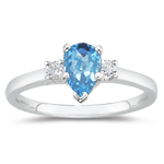 0.10 Cts Diamond & 6.02 Cts Swiss Blue Topaz Three Stone Ring in Platinum