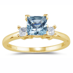 0.20 Cts Diamond & 1.05 Cts Aquamarine Classic Three Stone Ring in 18K Yellow Gold