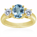 0.10 Cts Diamond & 4.50 Cts Aquamarine Classic Three Stone Ring in 18K Yellow Gold
