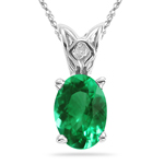 0.35-0.47 Cts of 6x4 mm AAA Oval Natural Emerald Scroll Solitaire Pendant in Platinum