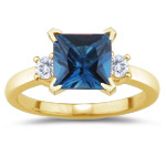 0.10 Cts Diamond & 1.19 Cts London Blue Topaz Ring in 18K Yellow Gold