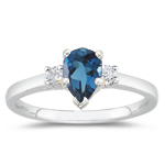 0.10 Cts Diamond & 6.02 Cts London Blue Topaz Three Stone Ring in Platinum