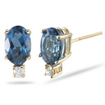 0.02 Cts Diamond & 1.14 Cts of 6x4 mm Oval London Blue Topaz Stud Earrings in 14K Yellow Gold