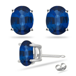 0.45 Cts of 5x3 mm AAA Oval Blue Sapphire Stud Earrings in 14K White Gold