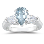 0.20 Cts Diamond & 4.55 Cts Sky Blue Topaz Three Stone Ring in 18K White Gold