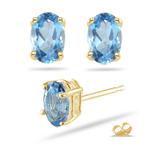9x7 mm Oval Swiss Blue Topaz Stud Earrings in 14K Yellow Gold