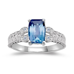 0.04 Cts Diamond & 7x5 mm Barrel-Cut Swiss Blue Topaz Ring in 14K White Gold
